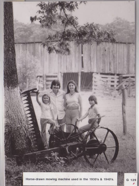 Family Poses with very old mowers.jpg