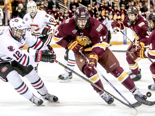Ethan Prow (12) of St. Cloud State and Blake Young
