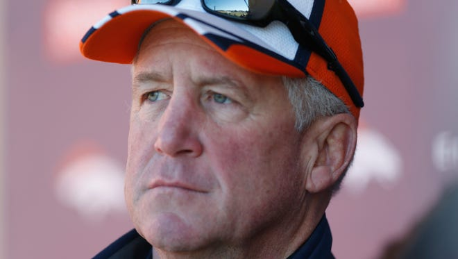 Denver Broncos coach John Fox considers a question from a reporter during a news conference Jan. 8, 2015, in Englewood, Colo.