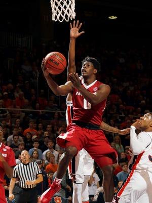 Arkansas guard Jaylen Barford (0) lays in a basket against Auburn during the first half of an NCAA college basketball game Saturday, Feb. 25, 2017, in Auburn, Ala.