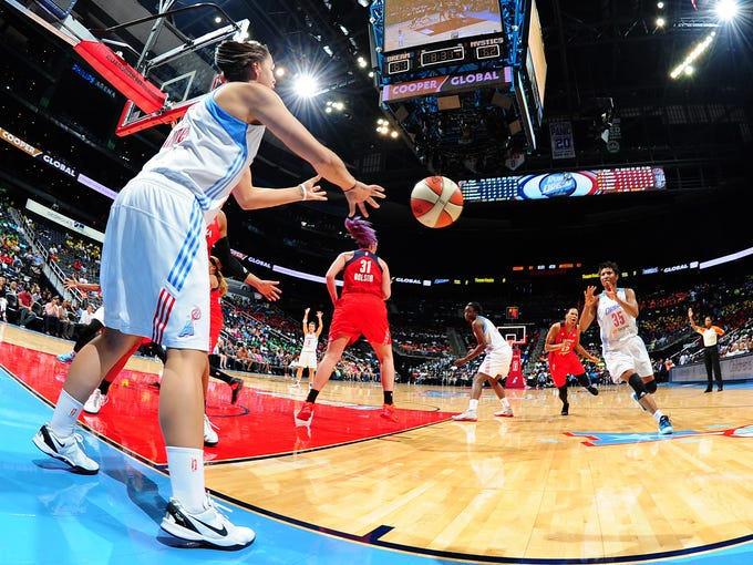 ATLANTA, GA - JUNE 18:  Shoni Schimmel #23 of the Atlanta Dream throws an inbounds pass to Angel McCoughtry #35 during the game against the Washington Mystics on June 18, 2014 at Philips Arena in Atlanta, Georgia.  NOTE TO USER: User expressly acknowledges and agrees that, by downloading and/or using this Photograph, user is consenting to the terms and conditions of the Getty Images License Agreement. Mandatory Copyright Notice: Copyright 2014 NBAE (Photo by Scott Cunningham/NBAE via Getty Images)