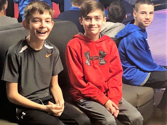 Turning 12 -  Alex Carlson celebrated his 12th birthday with friends and family at Showplace Newburgh. The sports themed party featured bowling and birthday cake. Alex is pictured here with Alec Moor and cousin Hayden Hunt.