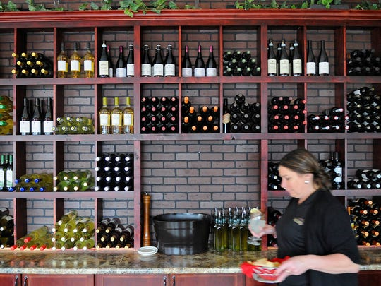 Bottles of wine line a wall at Bello Cucina in St. Joseph in 2015.