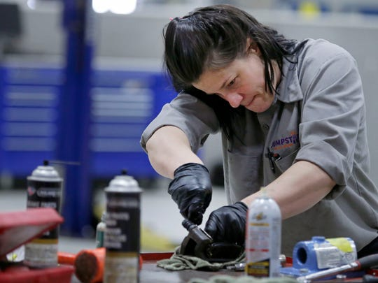Technician Jenna Bundy of JumpStart Auto Repair works on brakes Saturday, April 8 at the JJ Keller Transportation Center at Fox Valley Technical College. The shop was started by Harbor House and Christine Ann to service cars with the proceeds benefiting domestic violence survivors.