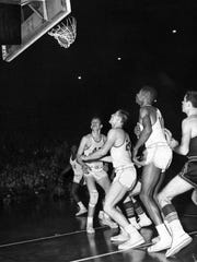 Bobby Plump's shot goes through the basket to win the state high school basketball championship for the tiny town of Milan over Muncie Central on March 20 1954. Plump is not visible in the photo.
