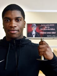 William Penn senior Sherby Hector holds up a miniature
