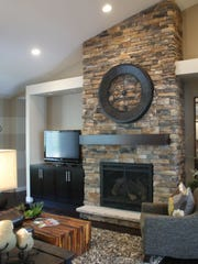 Gas fireplace with stone to the ceiling and built-in entertainment area.