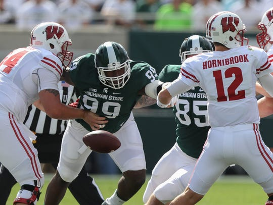 Michigan State Spartans Raequan Williams forces a fumble