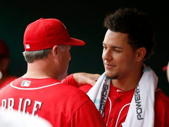 Cincinnati Reds manager Bryan Price (38) congratulates