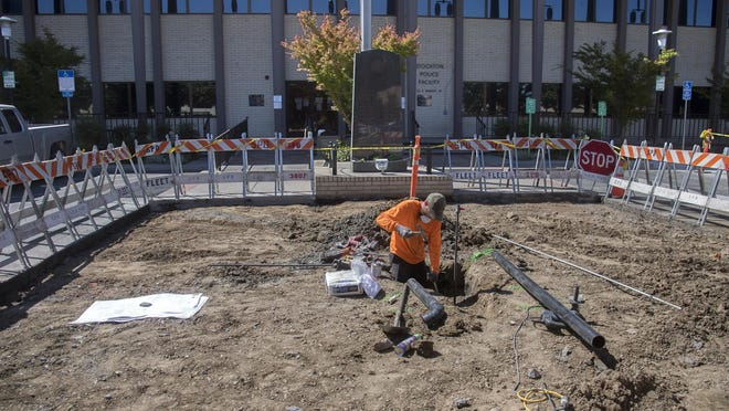 Daryl New with the Stockton-based Haley Contracting lays groundwork for the new San Joaquin County Peace Officer Memorial in front of the Stockton Police Department on Market Street in downtown Stockton.