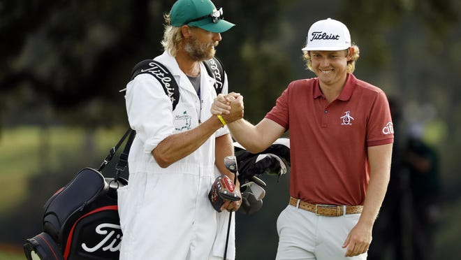 Cameron Smith celebrates with his caddie Matthew Tritton during the final round of the Masters.