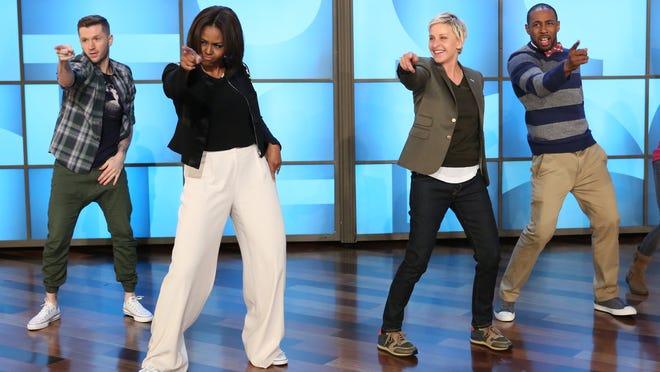 Michelle Obama dances with Ellen DeGeneres on March 12.
