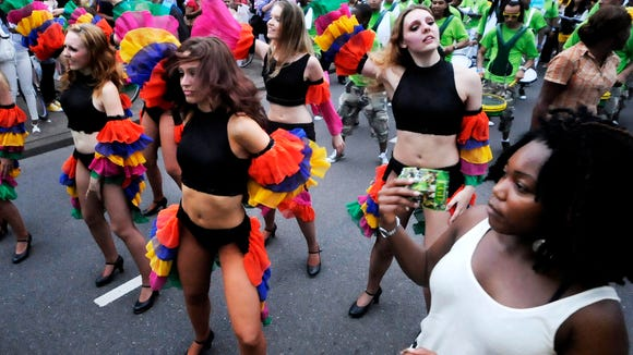 Dancers and drum bands perform in the streets of Rotterdam at Summer Carnival.