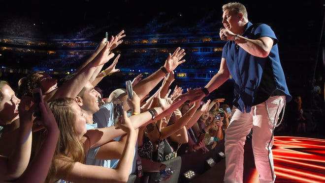 Gary LeVox of Rascal Flatts performs at the CMA Festival in Nashville last year. The act returns to Harrington for the Delaware State Fair July 25.