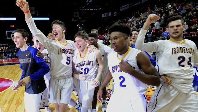 Irondequoit players celebrate at the final buzzer of the NYSPHSAA Boys Basketball Championships Class A final in Binghamton on March 19, 2017.
