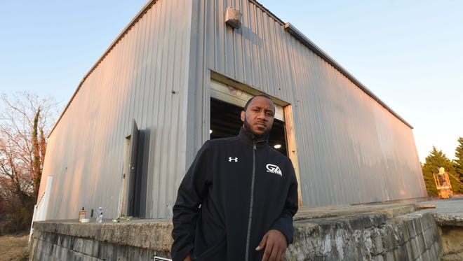 Jermichael Mitchell stands outside his new building that the City of Salisbury is refurbishing at 319 Truitt St. He is starting his after-school programs back up after his former building was turned into a parking lot on Calloway Street in Salisbury.