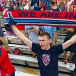 Indy Eleven fan Dan Osborn, of Indianapolis, cheers on the team during a 2014 game at Carroll Stadium in Indianapolis.