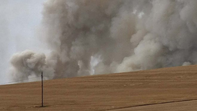 Smoke billows from a field burn in 2011.