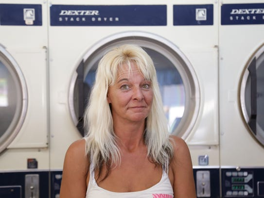 Lisa Zehner, standing in the Fourth Street Laundromat