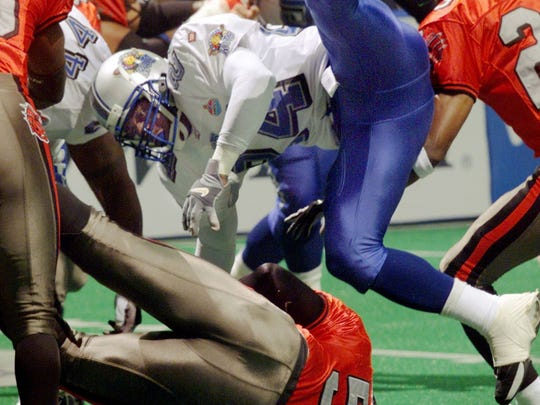 No. 8 Top 10 Sports Events: Nashville Kats defensive back Robert Davis, top, stops Grand Rapids Rampage's Thomas Bailey during the first quarter of the Arena Football League's playoff game at the Nashville Arena July 29, 2000.