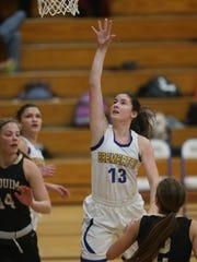 Bremerton High School's Elysabeth Lamoureux scores on a layup against Sequim.