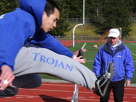 Greg Chapman, right, was an elite marathoner in the 1960s and 1970s and a longtime successful track and cross country coach.