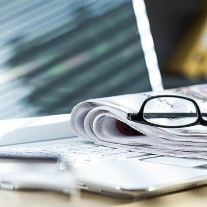 Newspaper on laptop