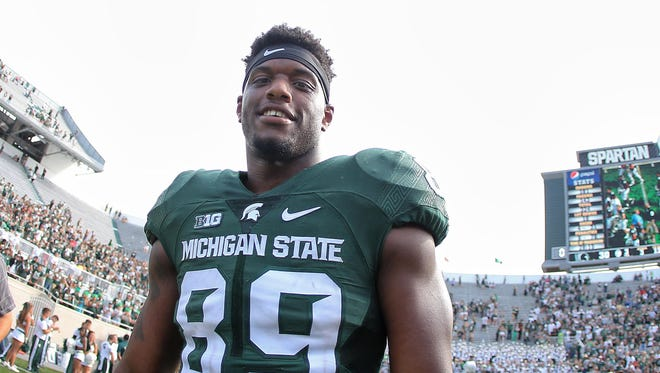 Michigan State defensive end Shilique Calhoun  walks off the field after a game against Central Michigan at Spartan Stadium.