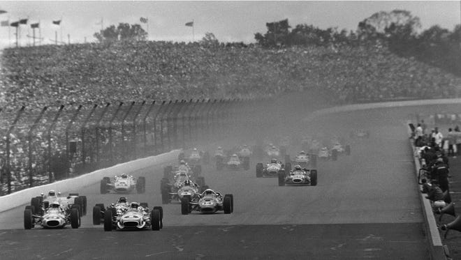Mario Andretti (1) leads the field at the start of the 51st running of the Indianapolis 500 at Indianapolis Motor Speedway May 30, 1967. The race had to be stopped for rain, and was restarted the following day. At far left is Gordon Johncock (3), and at center is A.J. Foyt (14), the eventual race winner. (AP Photo)