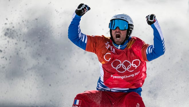 Back-to-back Olympic champion, France's Pierre Vaultier, roars in excitement after securing his gold title in Men's Snowboard Cross, Feb. 15, Phoenix Snow Park. The motocross like mash up of six snowboarders and a mix of obstacle courses, the Olympic event Snowboard Cross features a little bit of everything and Vaultier continues to hold the gold. Grace Hollars, Ball State at the Games