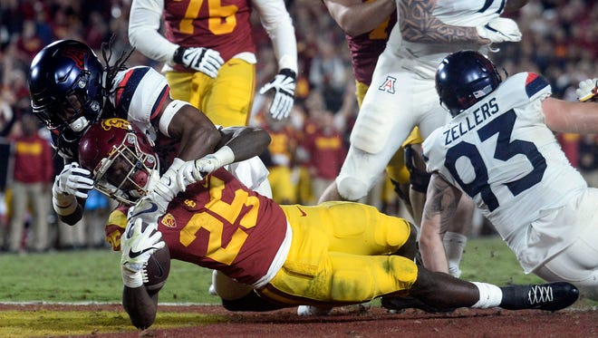 November 4, 2017; Los Angeles, CA, USA; Southern California Trojans running back Ronald Jones II (25) runs the ball in for a touchdown against the defense of the Arizona Wildcats during the second half at the Los Angeles Memorial Coliseum. Mandatory Credit: Gary A. Vasquez-USA TODAY Sports