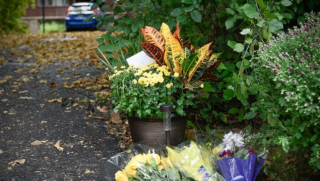More flowers and tributes sat Sunday, Sept. 4, at the driveway of Jerry and Patty Wetterling after news that Jacob's remains had been found. He was abducted in 1989.