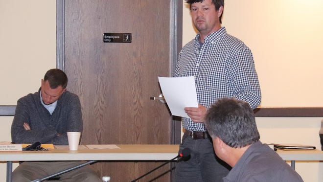 Wastewater Treatment Plant Superintendent Jake Kinkade responds to a question from Alderman Jerry Causer about the proposed purchase of a loader for his department at Monday's Pontiac City Council meeting. The council approved the purchase.
