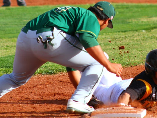 Mayfield's Justin Lopez reaches down to tag Alamogordo's Alex Ramirez during a pick-off attempt Tuesday evening.