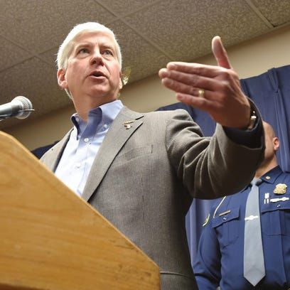 Gov. Rick Snyder talks to the media about the Flint