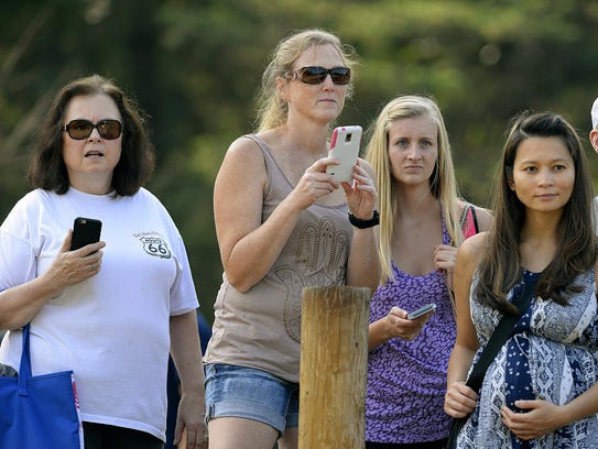 Spectators watch Saturday for their family members