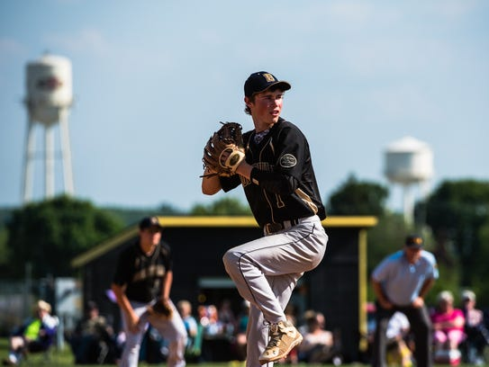 Biglerville's Chase Long aims down a pitch for Delone