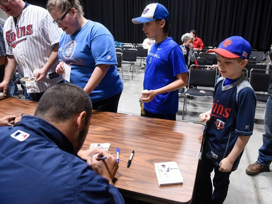 Minnesota Twins pitcher Hector Santiago signs autographs