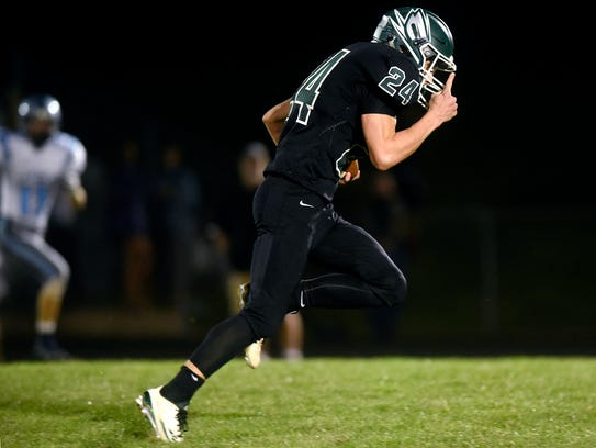 Williamston's Drew Bowen runs for a touchdown after