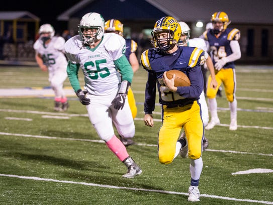 Delta's Tanner Lambert runs downfield Friday with New