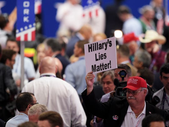 """A delegate holds up a sign that reads """"Hillary's Lies"""