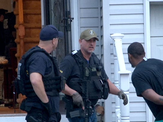 DEA and ATF agents are shown after taking James Smith,