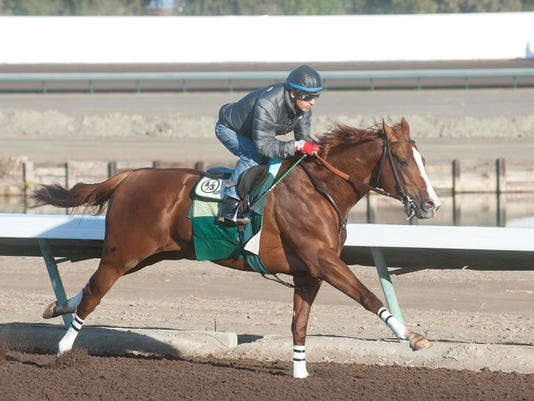 Victor Espinoza aboard California Chrome at Los Al.jpg