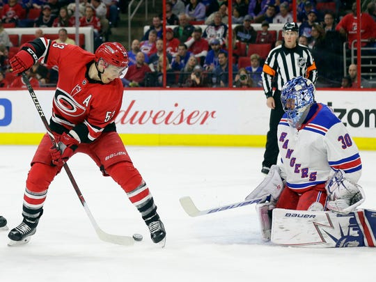New York Rangers goalie Henrik Lundqvist (30), of Sweden, blocks Carolina Hurricanes' Jeff Skinner (53) during the second period of an NHL hockey game in Raleigh, N.C., Saturday, March 31, 2018.  A new Buffalo Sabre, Skinner will be a Top 6 left winger for Sabres. He has 204 goals in his career, most at even strength.