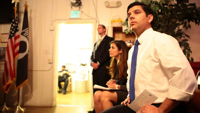 Rep. Raul Ruiz listens as a veteran speaks during an event held at the Joseph L. Stone Veterans of Foreign Wars Post 1534 in Desert Hot Springs in March 2015.