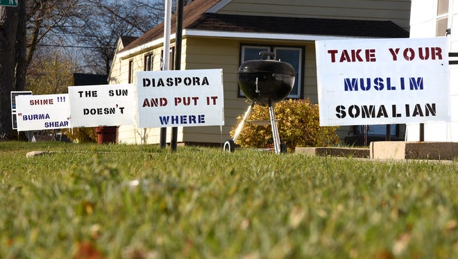 Steve Sorensen has a collection of signs in front of his home that say ÒTake your Muslim Somalian diaspora and put it where the sun doesnÕt shine!!!Ó shown Friday, Nov. 11, in St. Cloud.