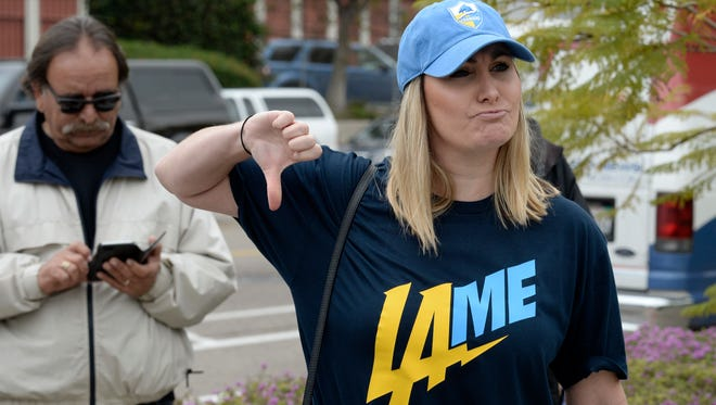 Bre Priest sports a T-shirt with an alternative to the Chargers new logo.