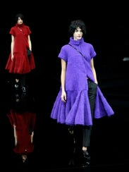 Models wear creations for Emporio Armani women's Fall-Winter