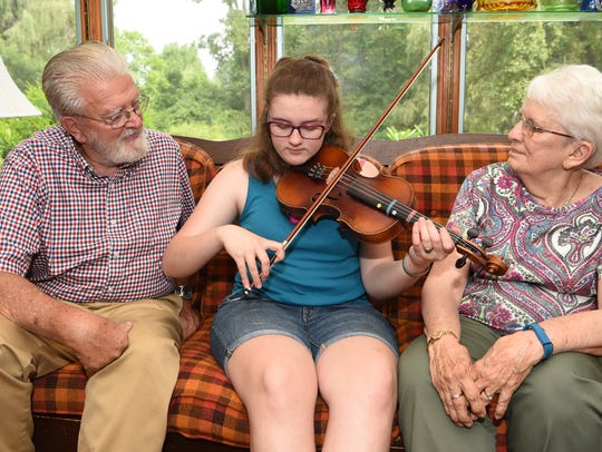 Cosette Veeder-Shave, 16, of Hyde Park plays the fiddle
