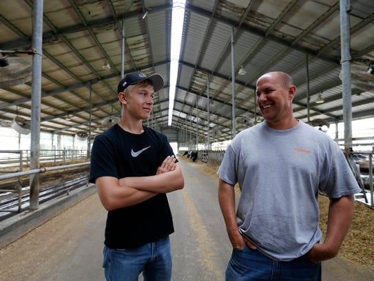Eli Dykstra, 16, stands with father Darin Dykstra,